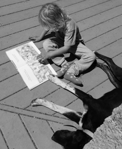 Girl reading with her dog